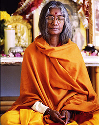 Shree-Maa-Meditating-in-Orange