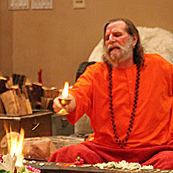 Swamiji-Offering-Light-to-Fire